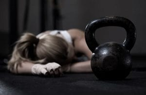 Woman tired after kettlebell workout