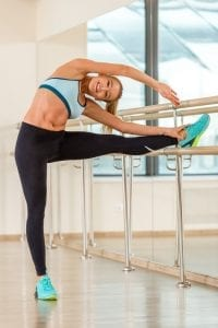 Young womanl doing barre exercise