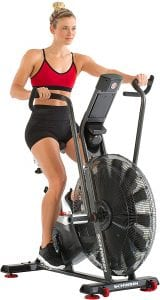YOung female using a stationary bike