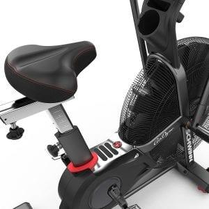 Closeup of exercise bike seat and flywheel
