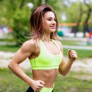 Woman running in partk FIIT Principle