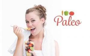 young woman eating a Paleo meal