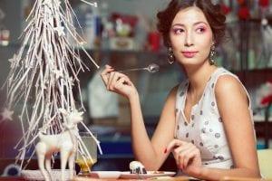 Woman eating dessert at Christmas