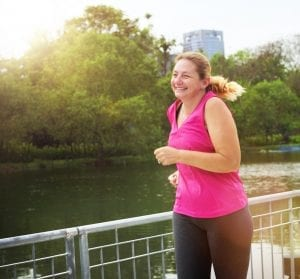 healthy weight loss per week - smiling woman jogging