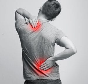 Backview of a man cliuching his aching back