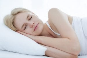 Closeup of a blonde woman sleeping on her side
