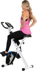 Back view of a young woman on an exercise bike