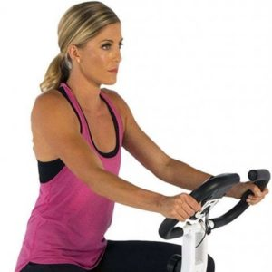 Close up of a young woman on an exercise bike