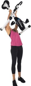 Woman lifting a light exercise bike