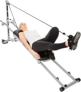 Woman using a home gym.