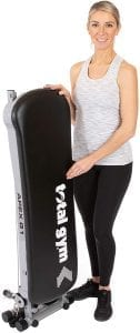 Woman with folded gym equipment.