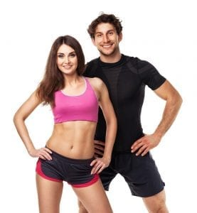Fit man and woman in workout gear