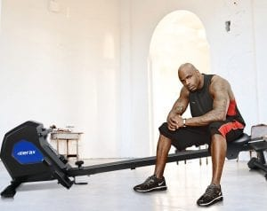 Man sitting on a Merax Magnetic Exercise Rower