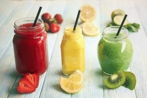 Refreshing fruit smoothies on a table