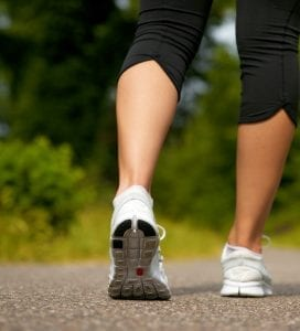 Get fit on a budget - back view of a woman's calves walking for exercise