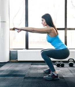 Young woman doing Squats