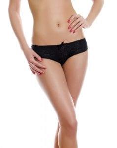 lose weight in your thighs - slim woman in underwear with hand on waist