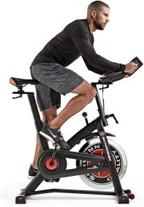 Young male cycling on a Schwinn IC3