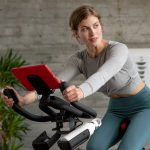 Young woman cycling on a Schwinn IC4 Indoor Exercise BIke