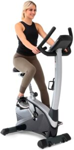 Young woman using a stationary bike