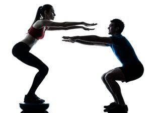Woman and man doing squats